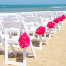 15559734 - wedding chairs set up for a ceremony at the seashore
